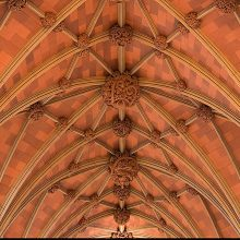cathedral ceiling with plaster ornaments after restoration