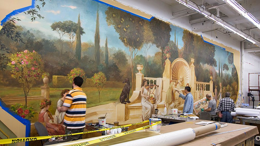 during mural restoration at Clemens Center
